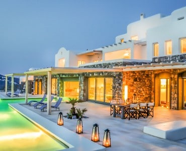 Rental Villa patio view with home ablaze with light